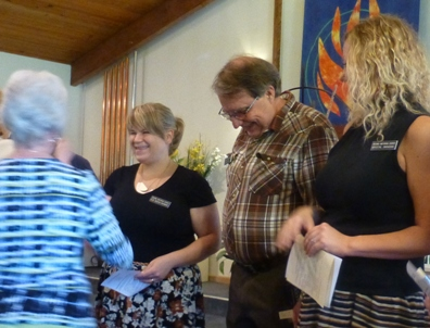 New members shaking hands with church board members during a recognition ceremony of their new membership.