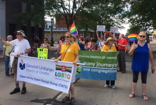 Church members holding banner as they march in Heartland Pride Parade