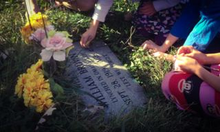 Children viewing grave of William Brown during Service Learning Project at Potter's Field Cemetery in North Omaha.