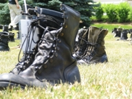 "Combat boots displayed in ""Eyes Wide Open: The Human Cost of War"" exhibit."