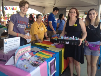 Second U members standing at our Pride festival booth