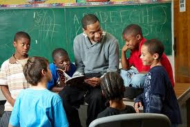 A Black Men United member reads to students